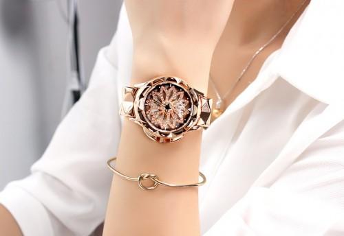 สุดยอดนาฬิกา Mashali สีพิงค์โกลด์ รุ่นเอกลักษณ์วงดอกไม้หมุน