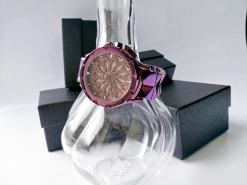 นาฬิกา Meriots สีม่วง รุ่นเอกลักษณ์กังหันดอกไม้หมุน