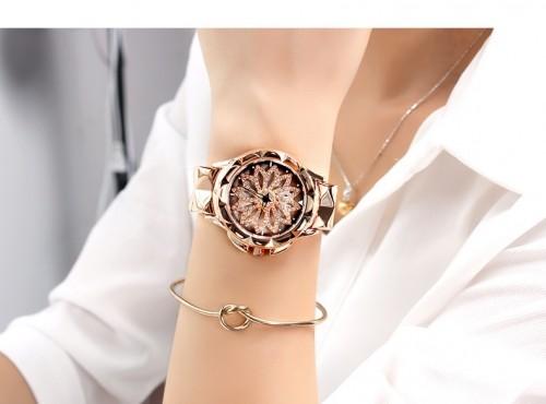 นาฬิกาสวยหรูสีพิงค์โกลด์ รุ่นเอกลักษณ์กังหันดอกไม้หมุน สวยมาก